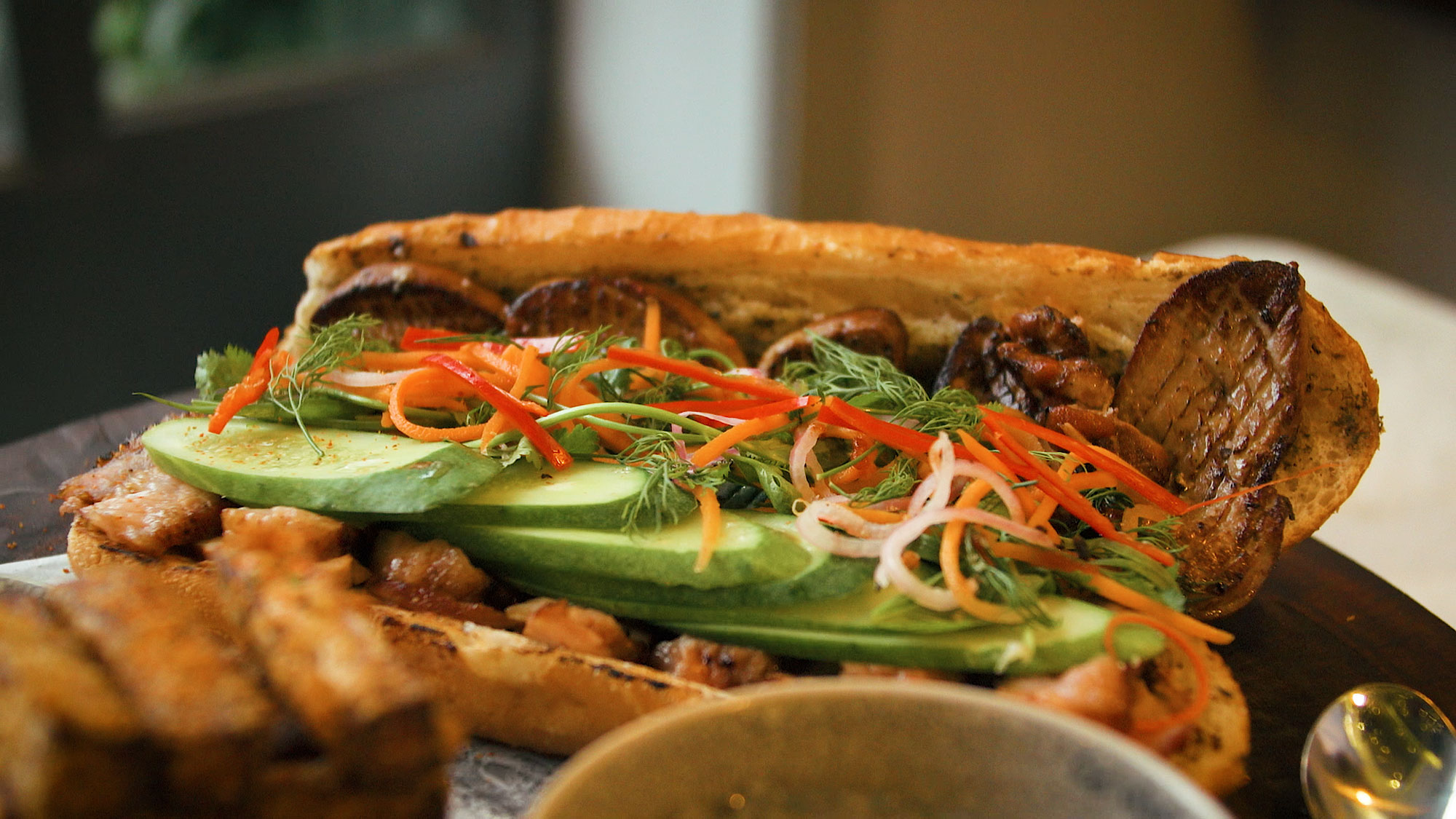 The Origins Of The $100 Banh Mi
