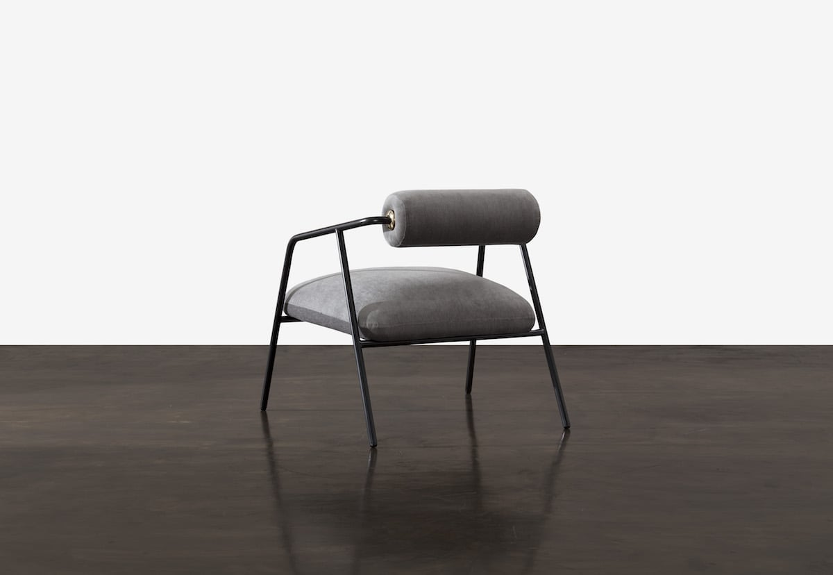 District Eight's Cyrus chairfeatures a tube steel frame with an upholstered seat and backrest that's available in both leather and fabric.