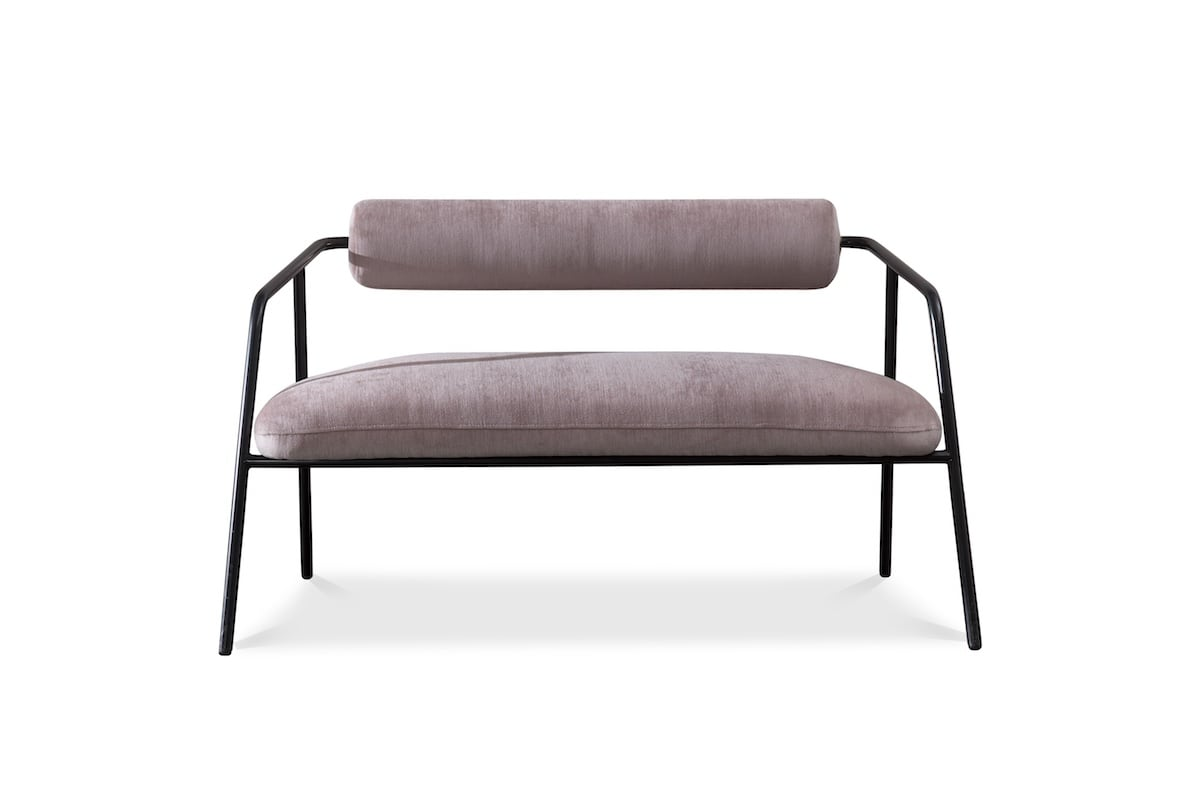 The District Eight Cyrus sofa also includes a cylinder-shaped backrest—a feature that adds to the collection's minimalist contemporary aesthetic.