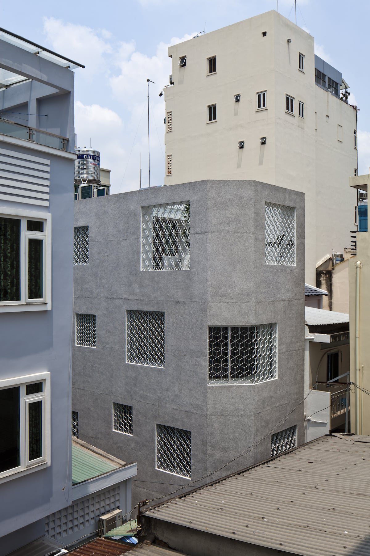 The HEM House, in an alley which constricts space and dulls access to sunlight, uses natural light and wind to create a comfortable living experience. // Design by SDA  Architects // Image courtesy of Hiroyuki Oki