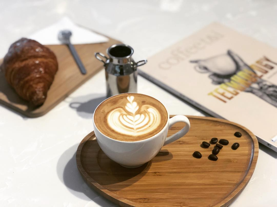 Coffee and croissant at Ama coffee