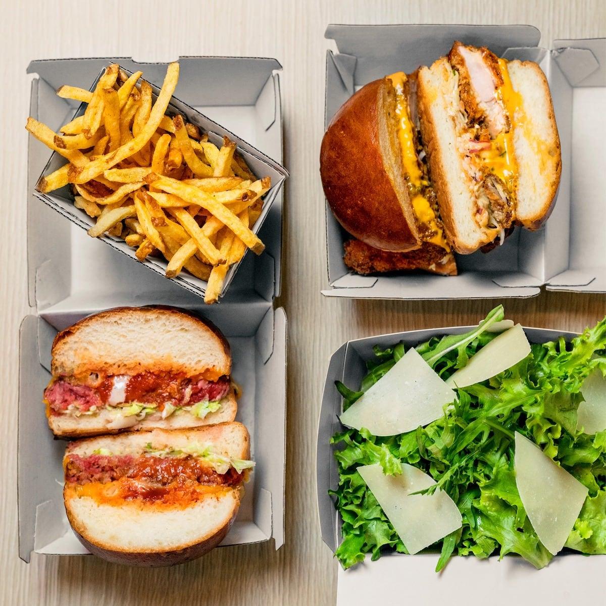 Burgers, salad and fries at Marcel Burger