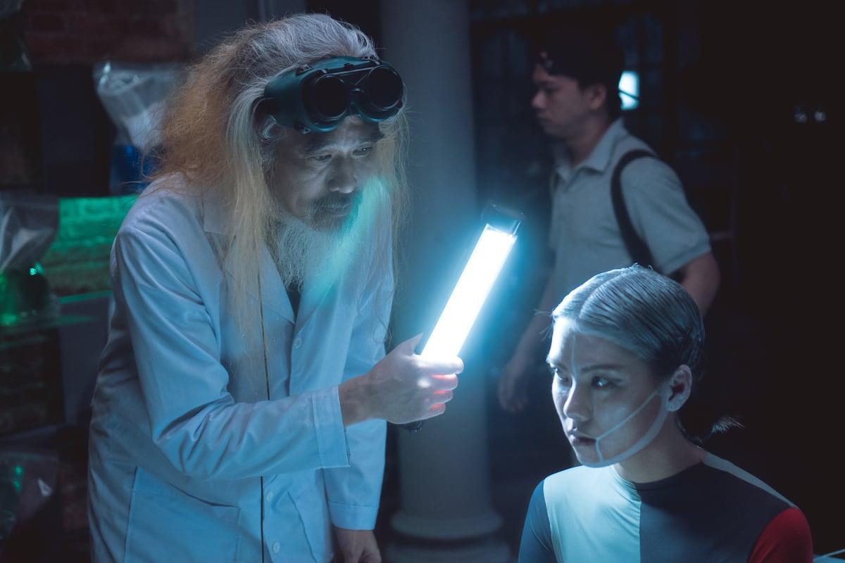 Cau Boi as a Dr. Frankenstein bringing Thuc to life with make up byXi Quan Le